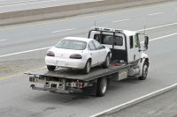 Car on recovery vehicle